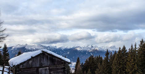 South tirol snow  mountains landscape and wood cabin winter travel