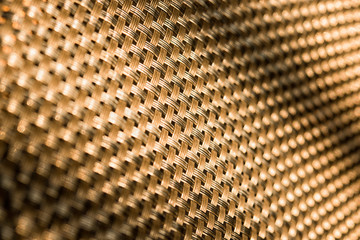 .Background. Gold diagonal grid closeup.