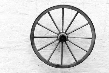 Old wooden cart wheel on the wall