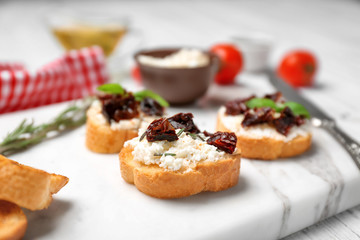 Printed roller blinds Appetizer Tasty bruschetta with sun-dried tomatoes on board, closeup