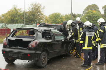 Firemen Rescuing Injured Person from Crashed Car 2