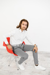 guy on red armchair