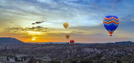 Hot air balloons sunset discovery Cappadocia, Anatolia, Turkey. Open air museum, Goreme national park.