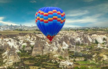 Hot Air balloons flying over Mountains landscape sunset Volcanic rocks, Cappadocia, Anatolia, Turkey.