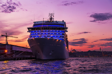 Cruises ocean liner sailing in to Bosphorus Strait that separates the Black Sea and the Sea of Marmara, Istanbul, Turkey.