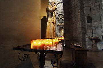 Tealight candles and statue in a church