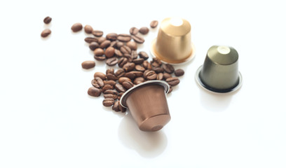 Espresso coffee pods and coffee beans on white background, Closeup view with details