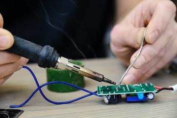 Repairing the power supply.