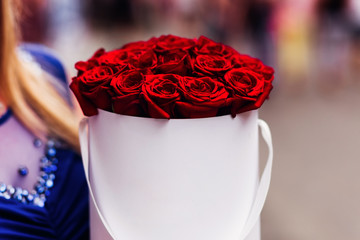 an incredible bouquet of beautiful red roses in white box