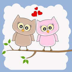 Two loving owls, happy birds are sitting on a tree.