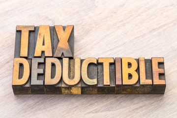 tax deductible word abstract in wood type