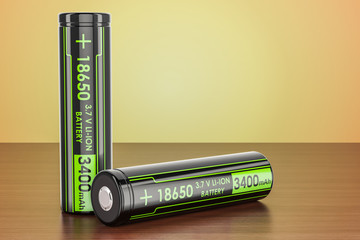 18650 Rechargeable Li-ion Batteries on the wooden table, 3D rendering