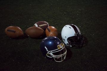 american football and helmets