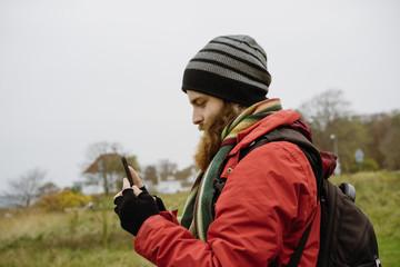 Man using phone in nature