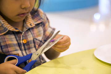 kids cutting art object on table