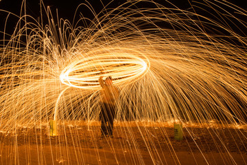 Fire shower by using steel wool photography.