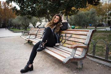 Stylish woman sitting on bench