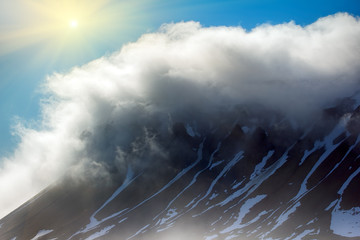 Cloud caught on the glacial sheet, nunatak in fog