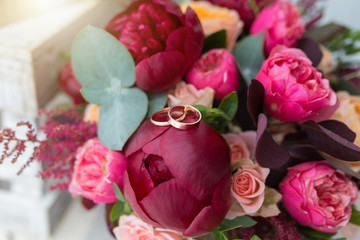 Beautiful wedding bouquet and gold rings