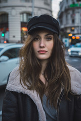 Woman in stylish cap on street