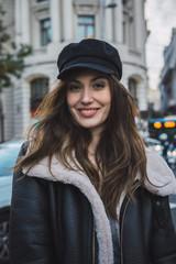 Woman in stylish cap on street