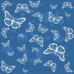 White butterflies on a blue background