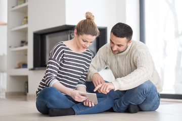 Young Couple using digital tablet on cold winter day