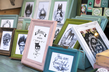 Photo frames on a Christams market fair with funny message about cat and home