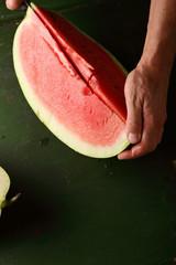 Watermelon slice on green background