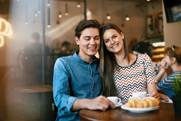 Couple With Coffee On Date. Beautiful Smiling People