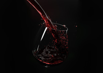 Wine splashes on black background