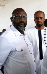 George Weah, former soccer player and presidential candidate of Congress for Democratic Change (CDC), is seen at a polling station in Monrovia