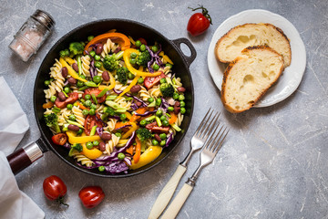 pasta salad with broccoli, vegetables, cabbage, tomato, beans, peas and greens, sweet peppers