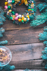 New Year's still-life. Christmas tree branches and ornaments on a wooden background