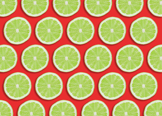 Green lime slices section design pattern isolated on red.