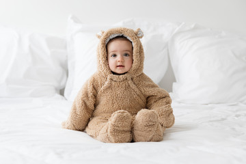 cute baby wearing bear suit