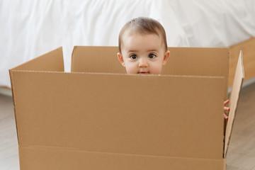 Cute baby in cardboard box