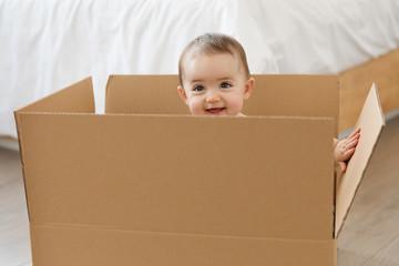 Smiling baby in cardboard box