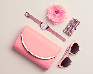 Fashion. Woman Accessories Set. Trendy Gold Watch, Summer Sunglasses, Glamour fashion Pink Clutch. Flower. Flat lay. Luxury Stylish Spring lady. Pastel Color