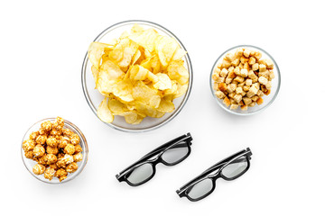 Fast food for watching film. Crisps, popcorn, rusks near glasses on white background top view