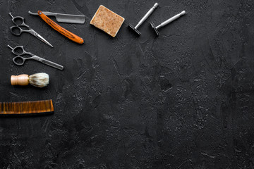 Vintage barbershop tools. Razor, sciccors, brush on black background top view copyspace