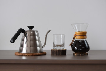 Drip coffee set. Steel kettle, glass and hand drip coffee maker minimalistic style
