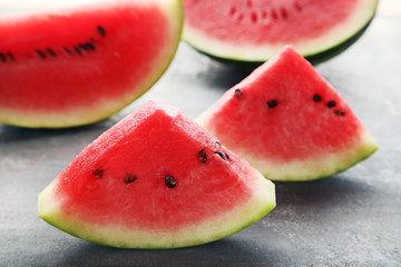 Slices of watermelons on grey wooden table