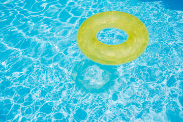 Inflatable rubber ring in a swimming pool