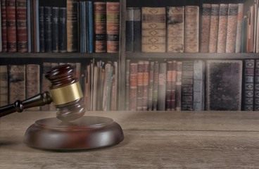 law theme, mallet of the judge, wooden desk, old books