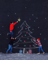 Father and two children decorating a conceptual Christmas tree