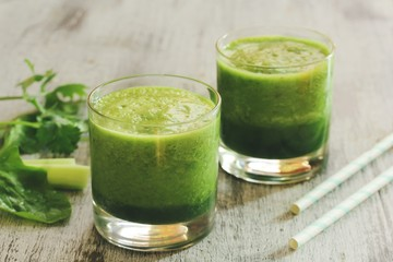 Green Smoothie with spinach celery cilantro, selective focus