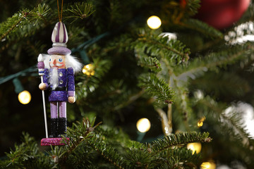 Toy nutcracker on a christmas holiday tree