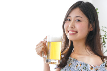 Young woman takeing alcohol at home