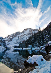 snowy mountain lake with mountains and blue sky